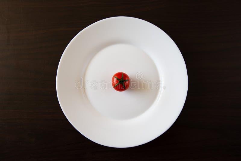 Mini pomodoro del piatto immagini stock libere da diritti