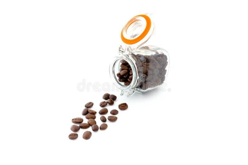 Mini Preserving Jar fyllde med kaffebönor royaltyfri foto