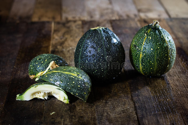 Mini pumpkin on a wooden table, black background stock photography