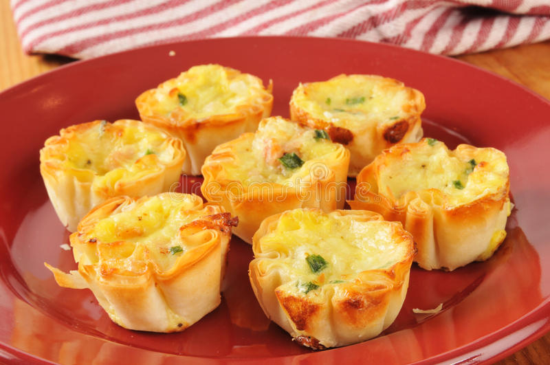 Mini quiche with bacon bits royalty free stock photos