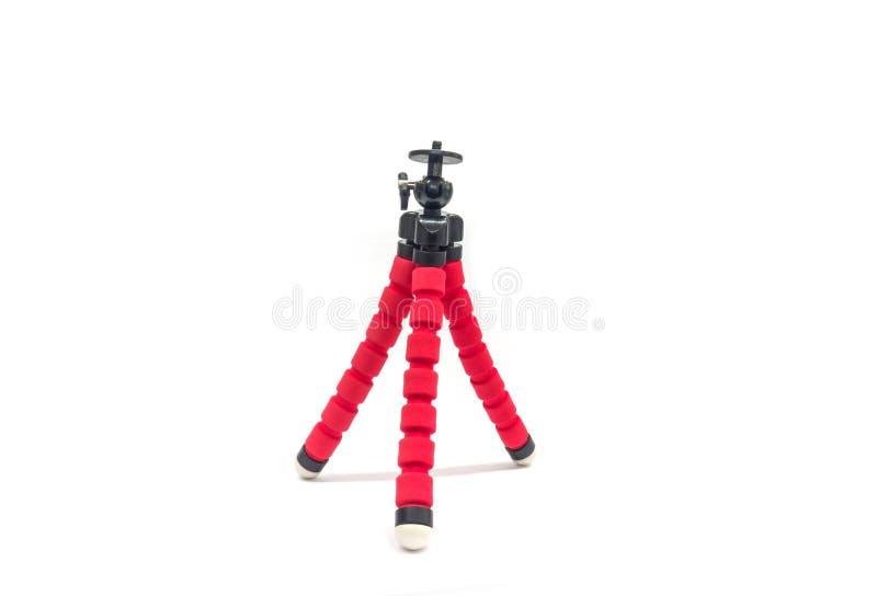 Mini roter Stativ lokalisiert auf weißem Hintergrund, mit Beschneidungspfad stockfotos