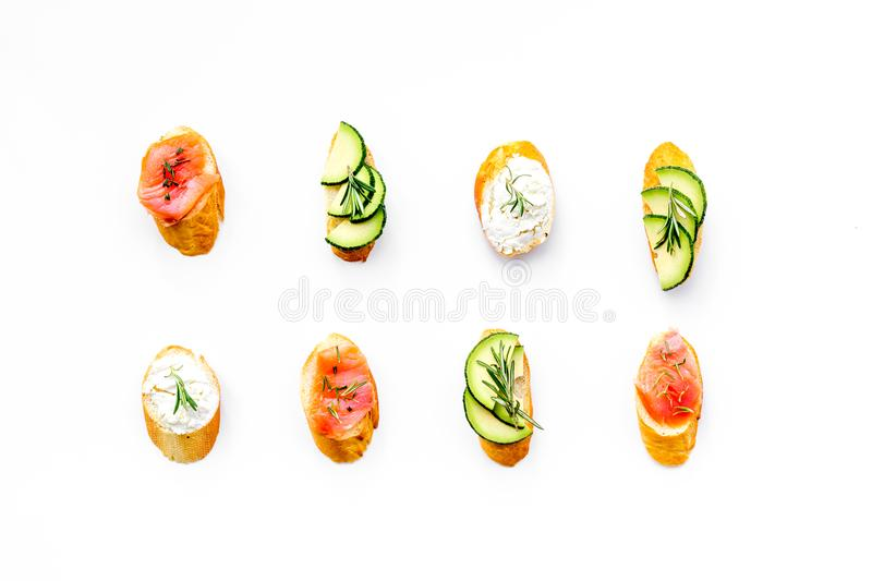 Mini sandwich set with french baguette, cheese and avocado on white background top view stock photography