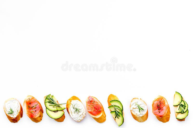Mini sandwich set with french baguette, cheese and avocado on white background top view mock up royalty free stock photography