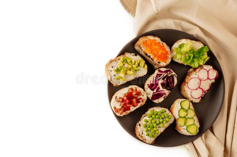 Mini sandwich set with french baguette, cheese, fish and avocado on white background top view mock up. copy space to the left royalty free stock images