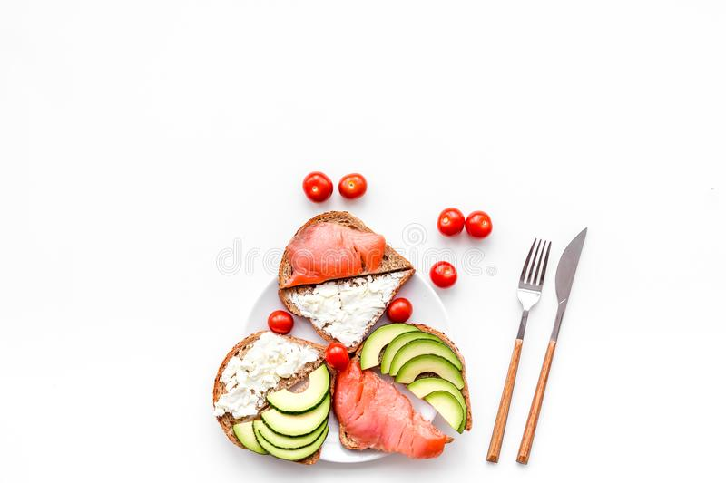 Mini sandwich set with french baguette, cheese, fish and avocado on white background top view mock up royalty free stock photography