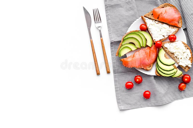 Mini sandwich set with french baguette, cheese, fish and avocado on white background top view mock up stock image