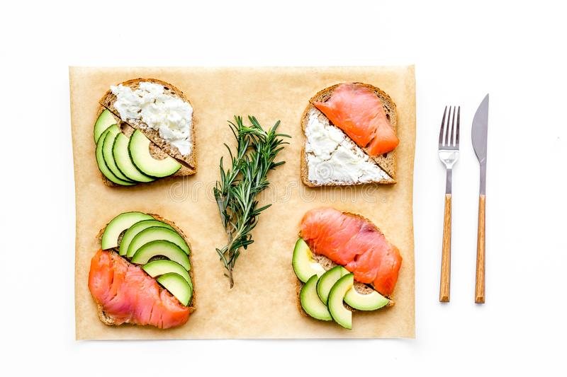Mini sandwich set with french baguette, cheese, fish and avocado on white background top view stock image