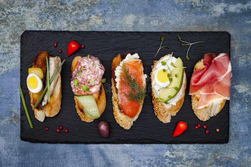 Mini sandwiches food set. Brushetta or authentic traditional spanish tapas for lunch table. Delicious snack, appetizer, antipasti stock photos