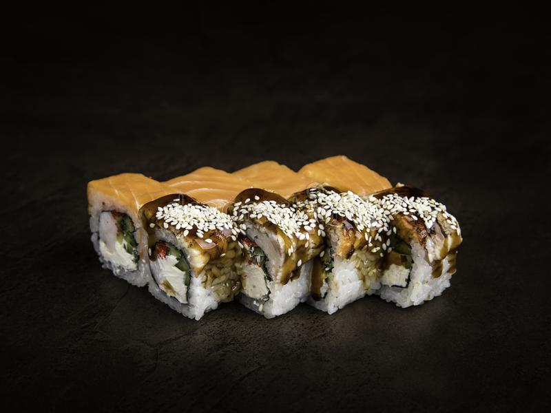 Mini-set of two types of rolls in the Japanese style on a dark background side view royalty free stock photo