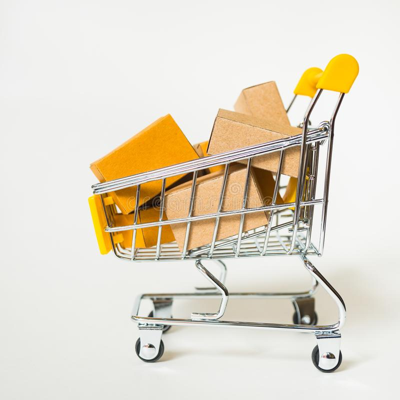 Mini shopping cart contain paper box using as e-commerce, online. Shopping and business marketing concept, background, basket, buy, carry, commercial, consumer stock images