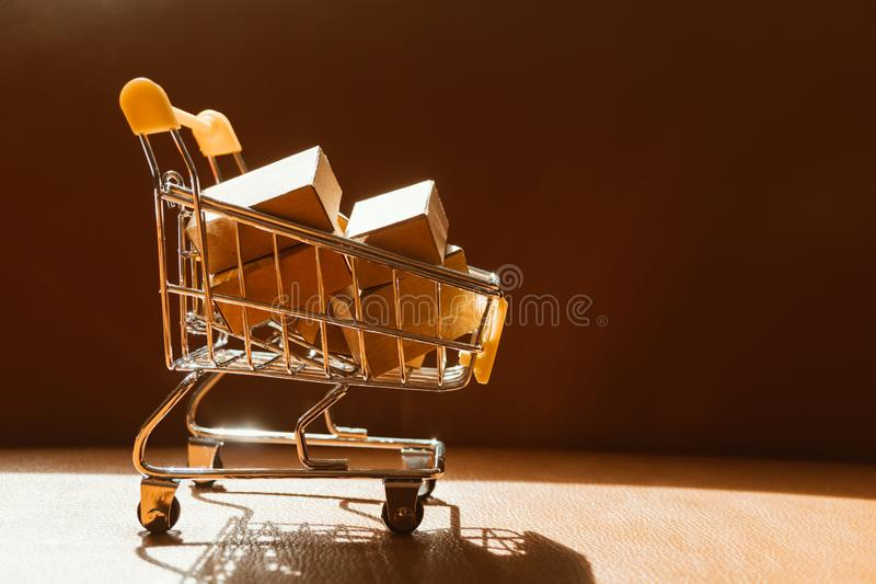 Mini shopping cart contain paper box using as e-commerce, online. Shopping and business marketing concept, background, basket, building, buy, carry, commercial royalty free stock image