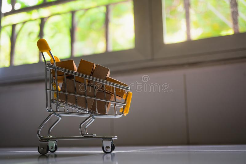 Mini shopping cart contain paper box using as e-commerce, online. Shopping and business marketing concept, background, basket, buy, carry, commercial, consumer royalty free stock photos