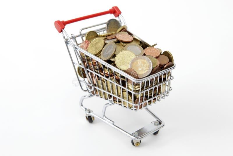 Mini shopping cart with euro coins stock photo