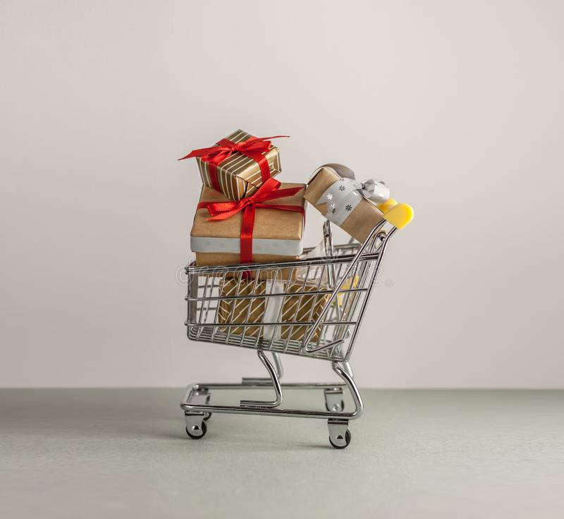 Mini shopping cart with boxes with presents. Mini shopping cart full with boxes of presents royalty free stock photo