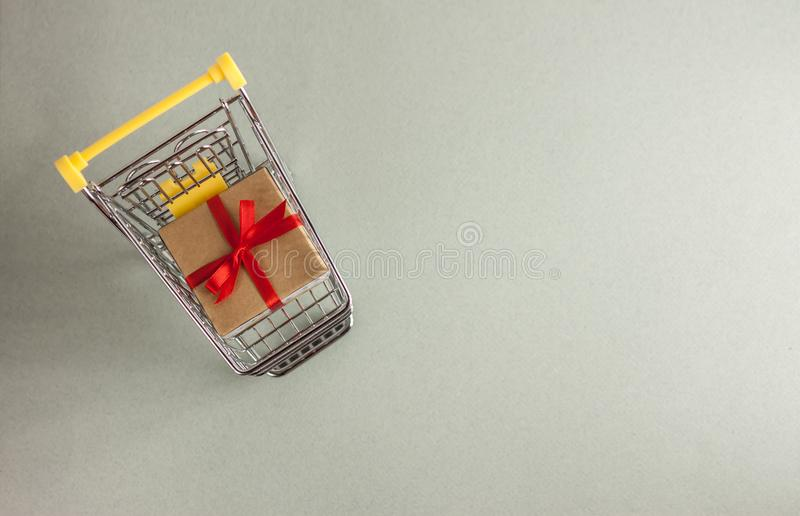 Mini shopping cart with boxes with presents. Mini shopping cart full with boxes of presents royalty free stock images