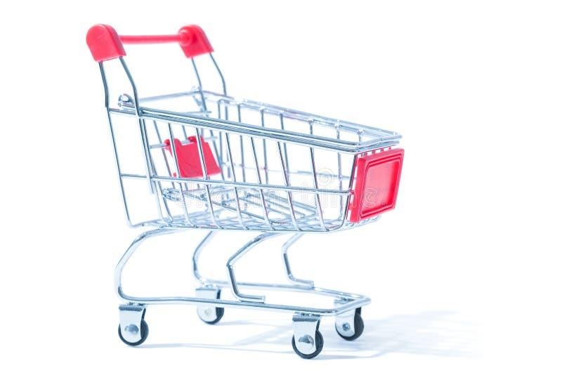 Mini shopping cart isolated on white stock photos