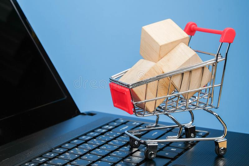 Mini shopping cart lover or shopaholic concept royalty free stock photography