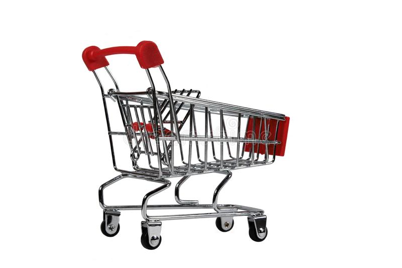 Mini Shopping Cart Side View Isolated On White. Empty mini shopping cart isolated on white with selective focus and shallow depth of field royalty free stock images