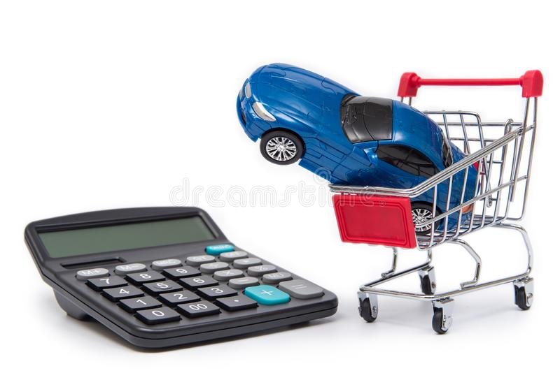Mini shopping carts and calculators with toy cars on white background. stock photo
