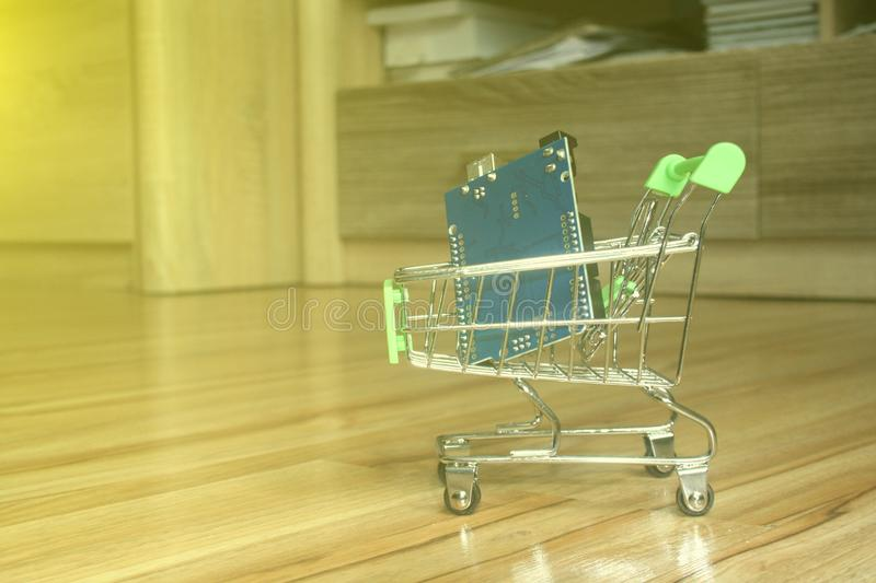 Mini shopping trolley with an arduino board as a concept of purchasing electronic components stock photography