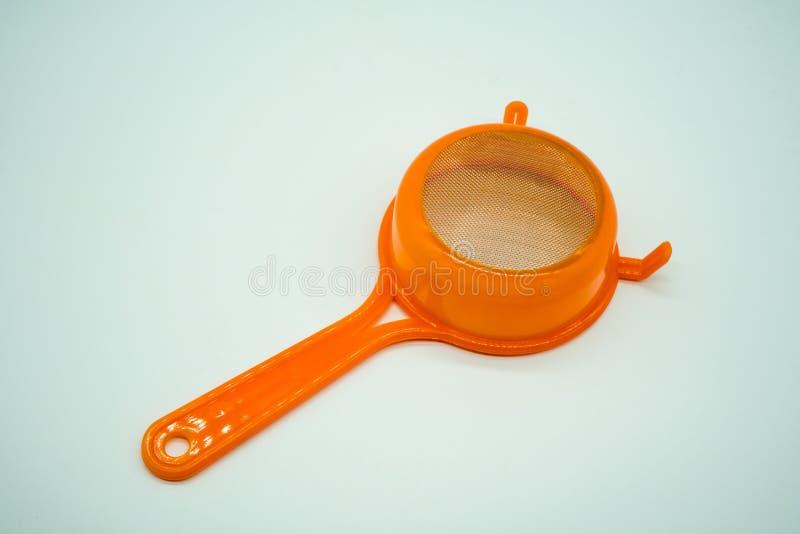 Mini tamis de cuisine avec la poignée en plastique orange image stock