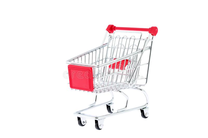 Mini toy metal shopping trolley cart with red handle and four black wheels isolated on white background. Supermarket shopping,. Mini toy metal shopping trolley stock image