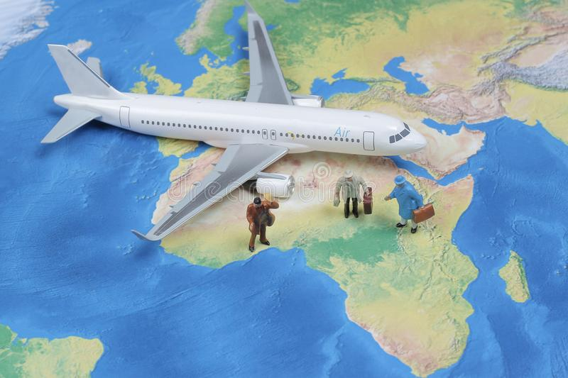 Mini traveler with airplane, travel and business concept. stock image