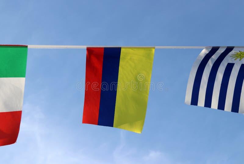 Mini- tygstångflagga av Colombia i Tricolor blå och röd färg för Nacional guling som, hänger på reptorkduken royaltyfri fotografi