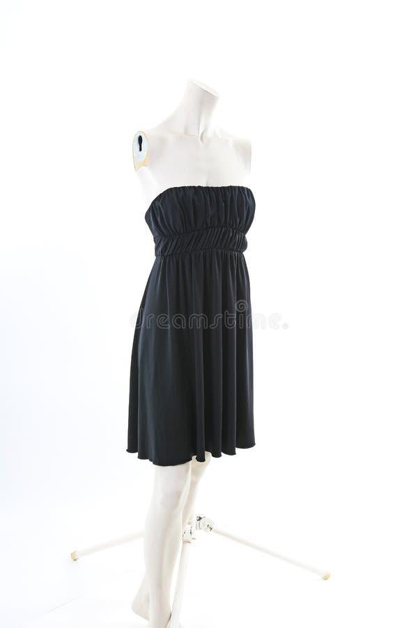 Mini vestido preto na estatueta decapitado da boneca da costureira da exposição de pano do manequim Roupa de desenhador de moda fotografia de stock