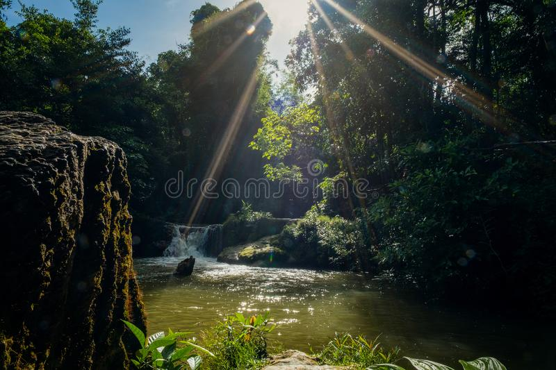 Mini waterfall and sunset sunny beams, travel destinations background, Forest viwe river Kroeng Krawia Waterfall, Kanchanaburi, stock photos