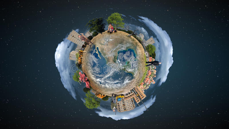 Mini world concept. Mini world with the different elements on its surface royalty free stock photo