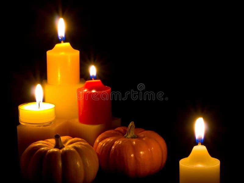 Mini zucche e candele fotografia stock