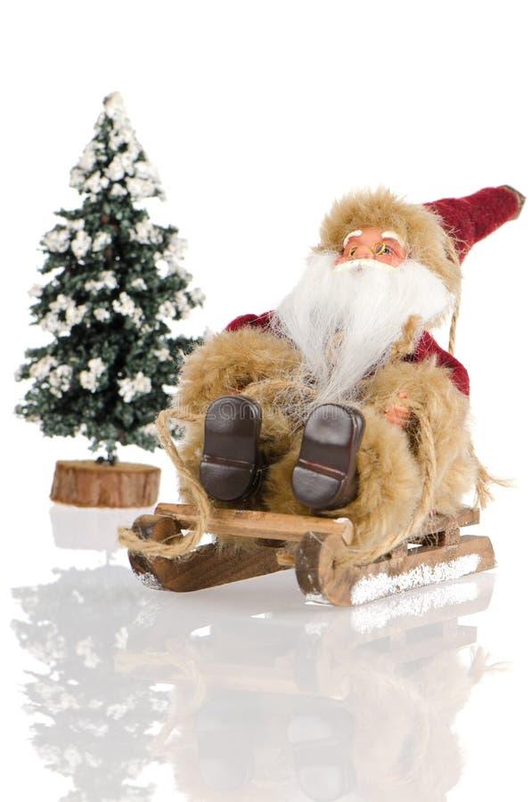 Miniatura de Papai Noel no trenó imagem de stock royalty free