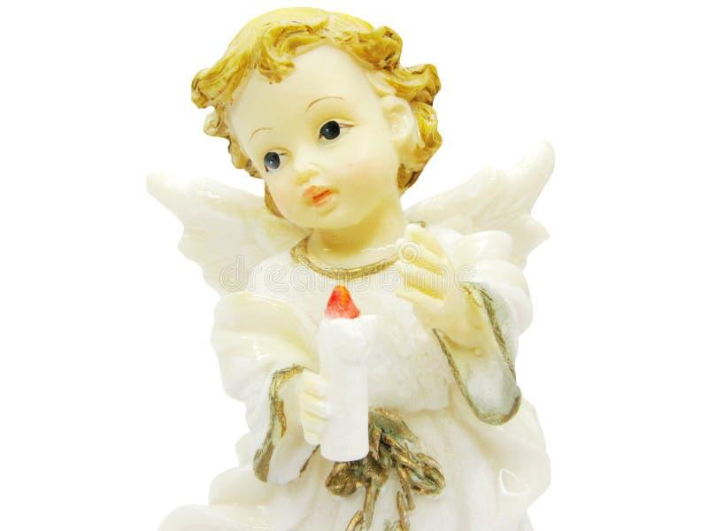 Miniatura del ángel que lleva a cabo una vela foto de archivo libre de regalías