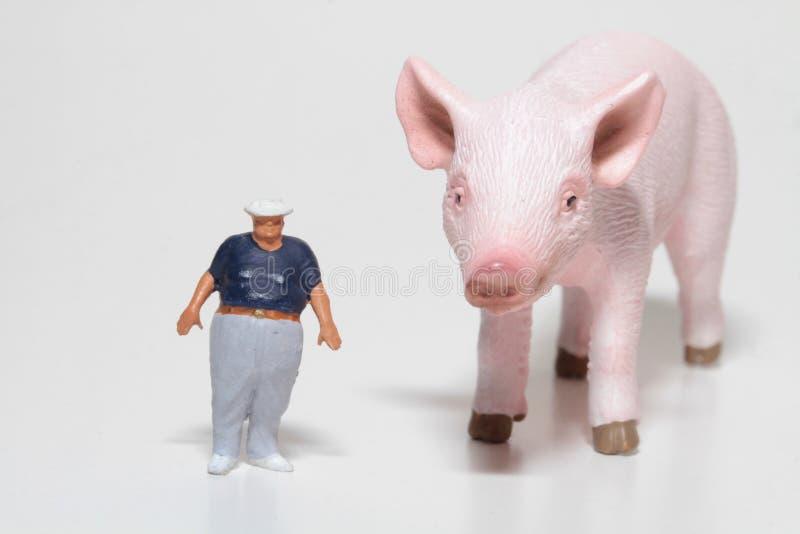 Miniatura gruby mężczyzna z gigantyczną wieprzowiną zdjęcia stock