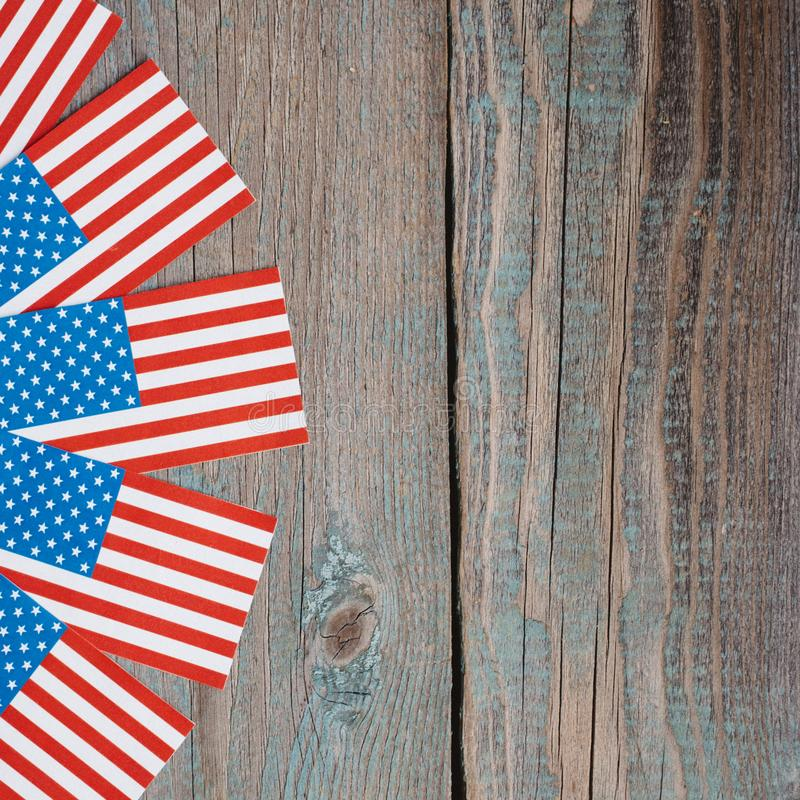 miniature American flags on brown wooden table royalty free stock photography