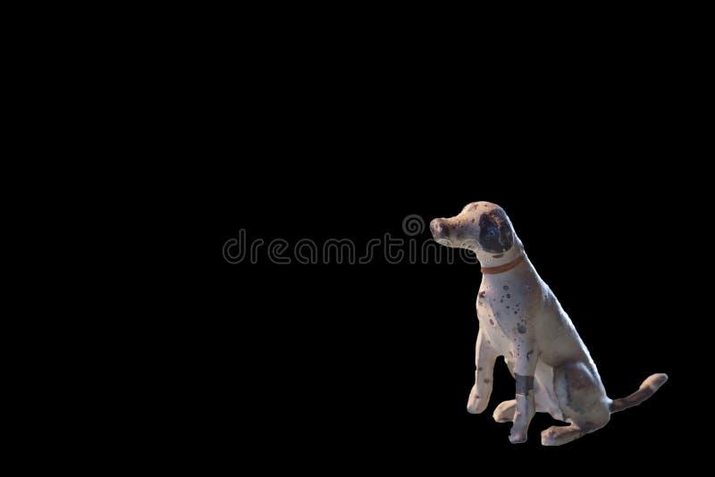 Miniature antique minuscule de chien d'avance, contre le noir avec l'espace de copie photographie stock libre de droits
