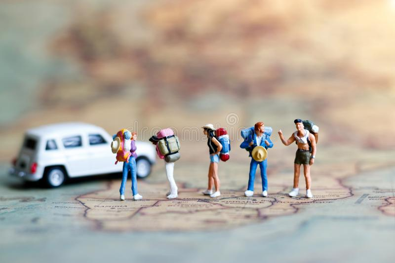 Miniature backpacker on map with car, Concept of Travel around royalty free stock image
