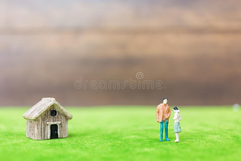 Miniature bamboo house and couple stock photography