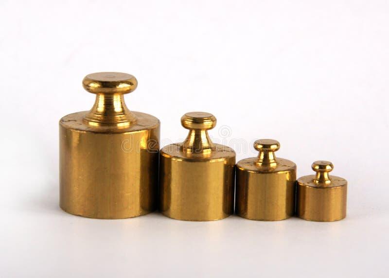 Miniature bronze vintage weights stock photo