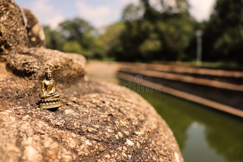Miniature Buddha statue on the old ruin. The Buddha also known as Siddhārtha Gautama, was a mendicant, meditator, and spiritual teacher who lived in royalty free stock image