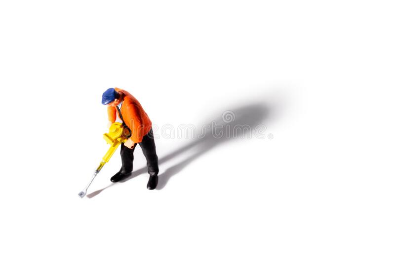 Miniature Builder worker with pneumatic hammer drill royalty free stock photography