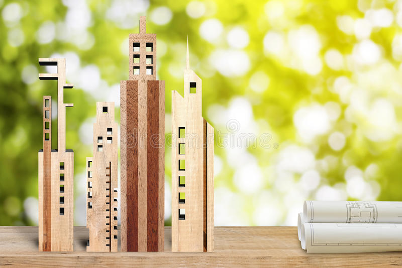 Miniature building made from wood on green bokhe background, eco. Miniature building made from wood on green bokhe background, Real estate concept royalty free stock images