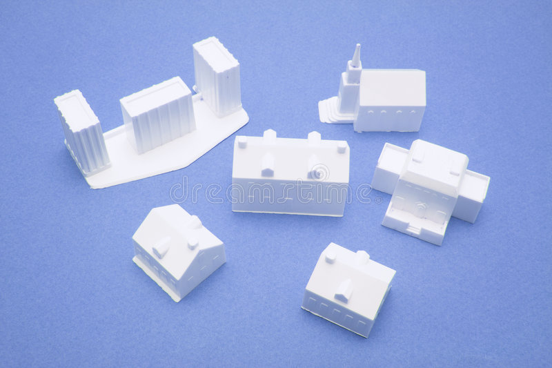 Miniature Building Models. On Blue Background royalty free stock photography