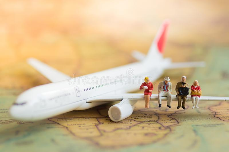 Miniature business people : businesses team waiting for airplane with copy space for travel around the world, business trip travel royalty free stock photography