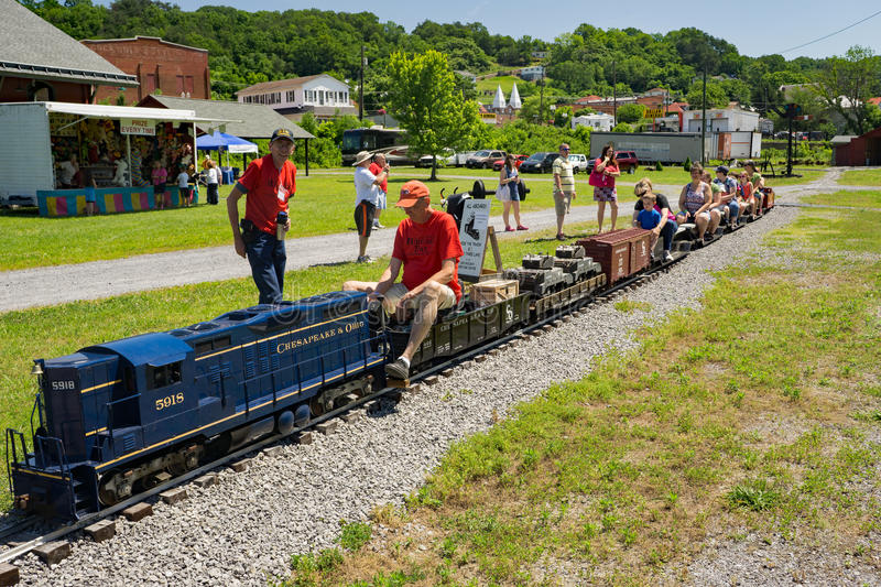Miniature C&O Train Ride. Clifton Forge, VA – June 3rd: Children enjoying a miniature C&O train ride at the annual Alleghany Highlands Heritage Day and stock photos