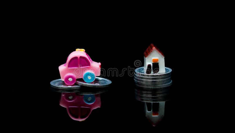 Miniature car and home model with stack coins, Loan Finance Concepts, Insurance and Real Estate Investment Concept. stock photos