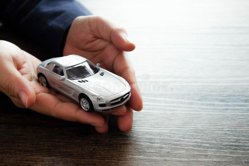 Miniature car model on hand, Auto dealership and rental concept stock photos