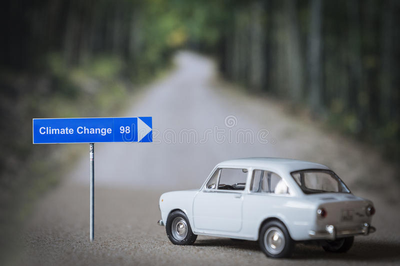 Miniature car on the road, choose address climate change stock photo
