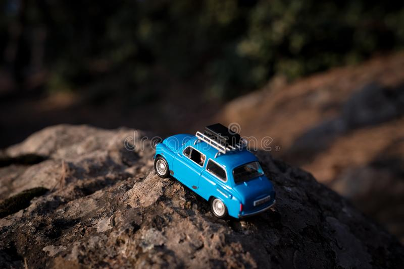 Miniature car travel with suitcases stock photography